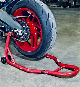 New in box black or red color spool lift rear motorcycle sports bike repair maintenance stand rack for Sale in Covina, CA