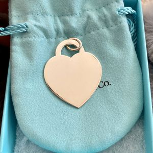 Authentic Tiffany & Co Silver Ultra Large Heart Tag Charm for Sale in Hayward, CA