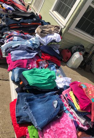 Yard sale jeans $3 kids clothes take a bag full of 20 pieces for $15 adult shirts $2-$4 dresses $4-$6 for Sale in Hayward, CA