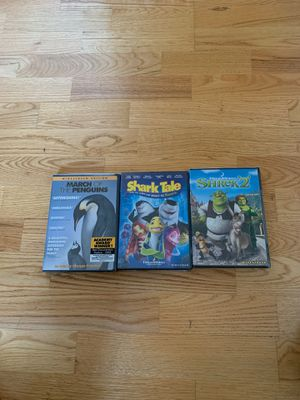 DVD Set Penguins Shark Tale Shrek 2 still sealed for Sale in Garden Grove, CA