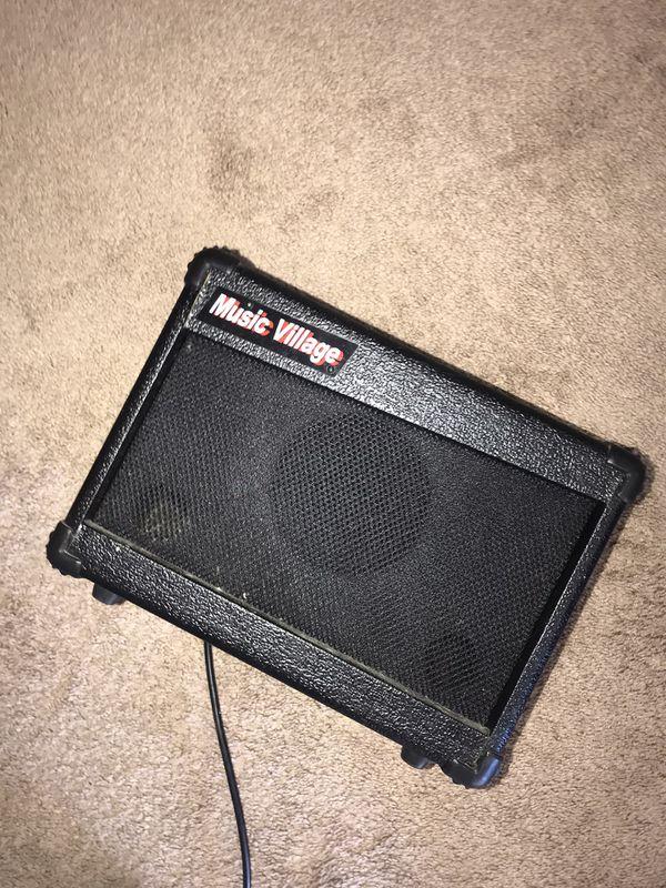 B.C Rich Electric Guitar w/ Music Village Amplifier