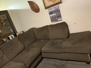 Beige 2piece sectional with an oversized chair w/storage ottoman. It is good condition with a few spots from wear & tear! for Sale in Tampa, FL