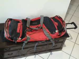 Travel bag Duffle gym bag with wheels and tot dolly handle camping back pack for Sale in Coconut Creek, FL