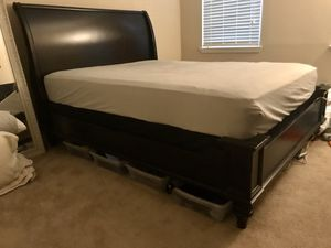Dark brown wooden queen bed frame for Sale in Cary, NC