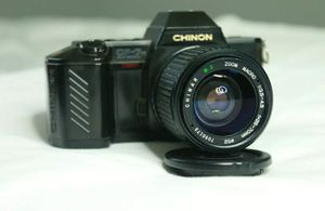 Chinon CP-7M DX SLR 35mm Film Camera Comes With Two Lenses and Carrying Case for Sale in Weston, FL