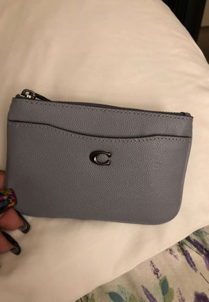 Blue Coach Coin and Money leather Wallet zips. Has a pocket in the front. It can hold money and some credit cards. Driver's license. New. for Sale in Pittsburg, CA