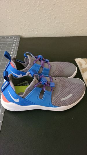Nike free run shoes size 7 youth or 8.5 in women. Only worn once, too big for me. for Sale in Spokane, WA