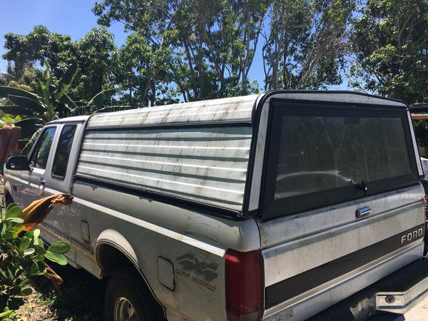 Truck camper with lock