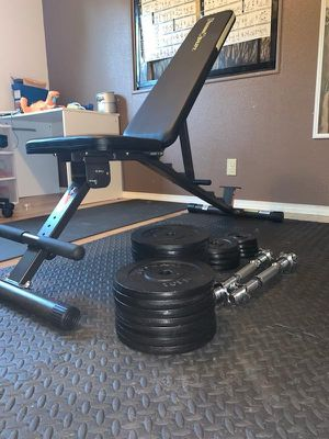 Weight bench, mat and weights for Sale in Vancouver, WA