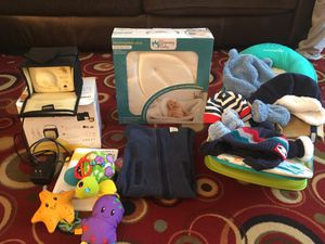 Breast pump,bath lotus,toys,baby bather,baby hats and gloves,baby onesie for Sale in Manassas, VA