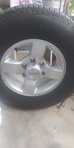 Nissan 6 lug aluminum rim with good tire 265/70 r16 for Sale in Chattanooga, TN