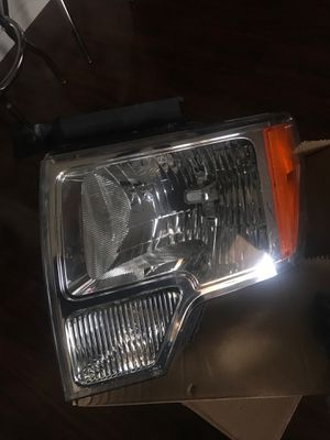 2009 to 2014 Ford F-150 headlight driver side OEM for Sale in Dallas, TX