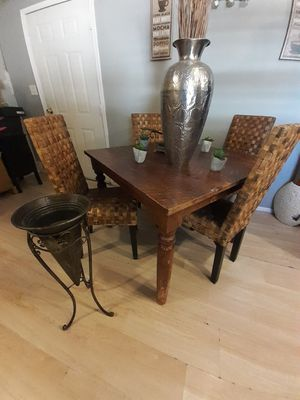 Table with 4 chairs and two plant holders for Sale in Phoenix, AZ