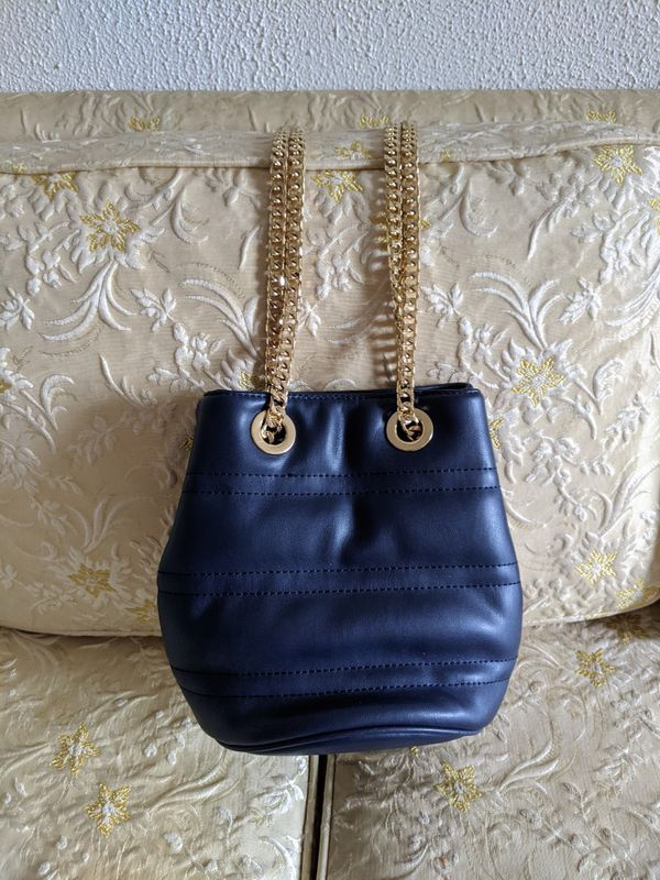 Blue purse with gold chain