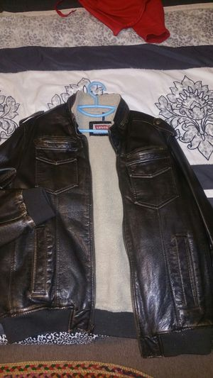 Levi's leather jacket color brown wore or it twice, size large too small for Sale in Cleveland, OH