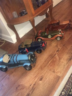 2 metal 2 wooden handmade classic cars for Sale in Columbia, MO