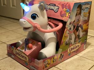 Brand New 6 volt Rideamals Play & Ride Unicorn with 20 sounds & light up horn. for Sale in Beaumont, TX