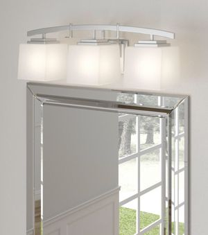 ARCHITECTURE 3-LIGHT BRUSHED NICKEL VANITY FIXTURE WITH ECTHED GLASS for Sale in Houston, TX
