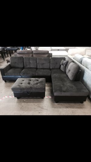 Dark grey microfiber sectional couch and ottoman for Sale in Kent, WA