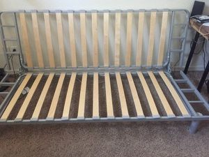 Ikea futon with teal slip cover. Disassembled for Sale in Oregon City, OR