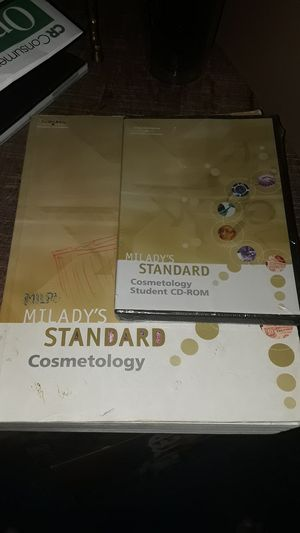 Milady's standard cosmetology book & DVD for Sale in Glendale, AZ