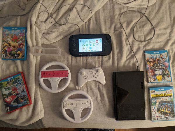 Wii U with 3 controllers, 2 wheels, and 4 games
