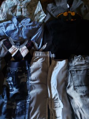 Size 4 kids winter clothes $10! 1 black Jean's, 1 blue camo pants, 1 sweatshirt, 1 relax pant, 1 vest, 2 button up long sleeves, 1 sweater, and 1 for Sale in Clovis, CA