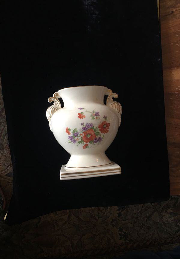 Beautiful flowers and trimmed in gold vase