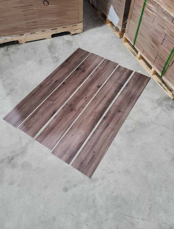 Luxury vinyl flooring!!! Only .65 cents a sq ft!! Liquidation close out! AD