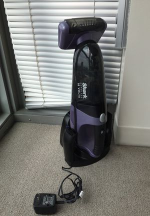 Shark cordless vacuume with charging station for Sale in Boston, MA