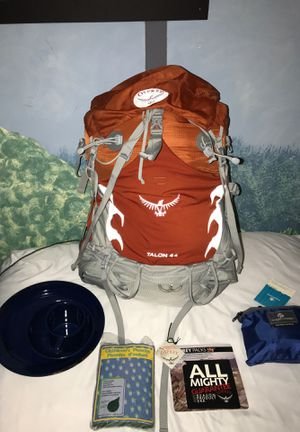 Osprey Hiking Backpacking Backpack 44L Orange Brand New with a ton of extra goodies like a brand new packable daypack for Sale in North Bethesda, MD