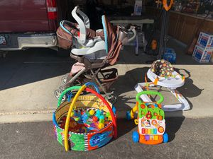 Carseat and stroller 70 dlls,playmate 10 dlls,sit and stand learning walker 5 dlls and baby walker 10 for Sale in Denver, CO