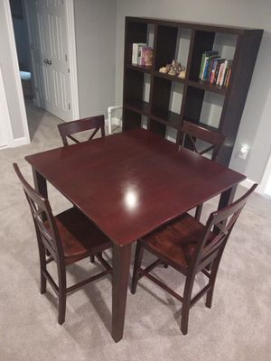 Table with four high chairs for Sale in White Plains, MD