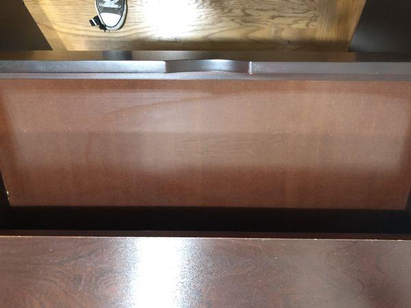 Dark brown storage cabinet with adjustable shelf and drawer