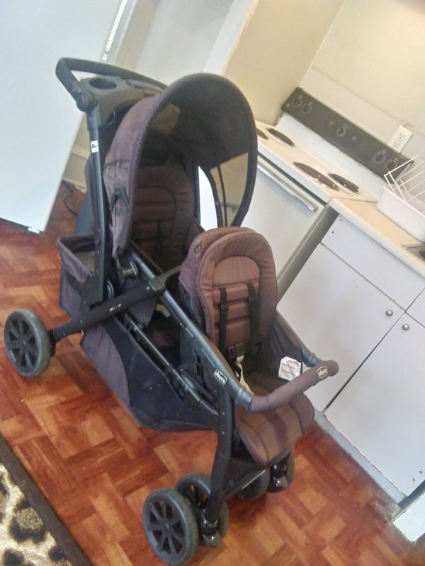 Two seater coach which converts into car seats made by chicco