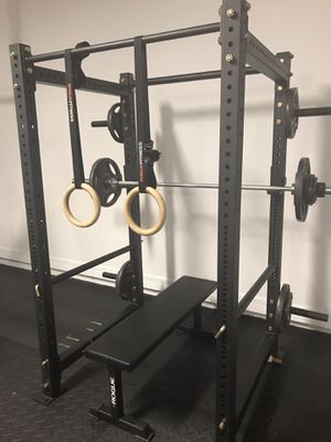 SQUAT / POWER RACK WEIGHT BENCH OLYMPIC WEIGHT SET AND WOODEN RINGS LIKE NEW !! for Sale in Zephyrhills, FL