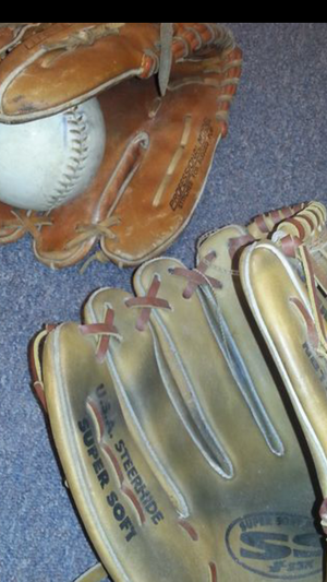 2 lefty softball gloves and ball.. in good shape for Sale in Schaumburg, IL