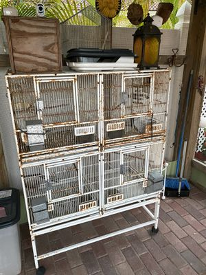 4 small cages on a stand w wheels for Sale in North Miami Beach, FL