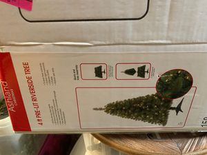 Christmas tree pre lit 4 ft with navy blue ornaments and ribbon for Sale in Marlboro Township, NJ