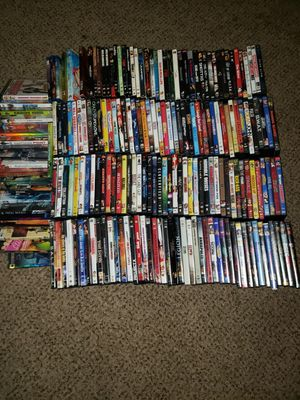 198 DVDS. 20 Unopened 2 stands that hold 45 each. for Sale in Stockbridge, GA