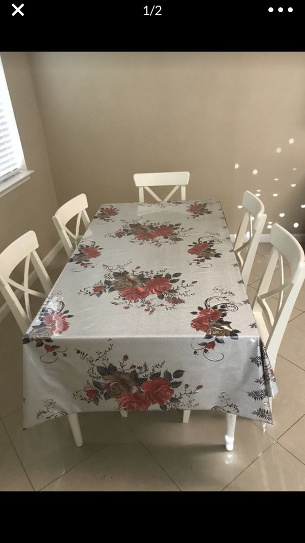 Good condition comes with six chairs and stands the table gets bigger you can fit eight I'm axing 280