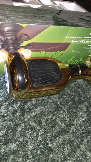 golden hoverboard with built in speakers and a charger for Sale in Nampa, ID