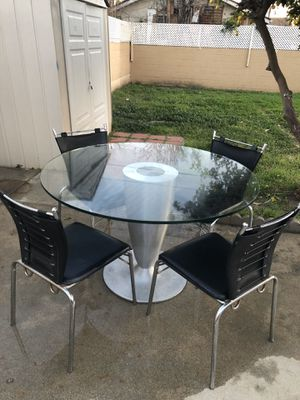 Dining glass table with four chairs for Sale in Los Angeles, CA