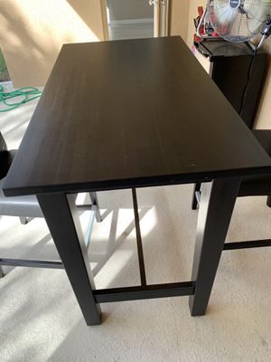 Tall dark table with 2 bar stool chairs. 4ft x 28in x 42in for Sale in Dover, FL