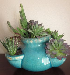 Teal ceramic vase with artificial succulents for Sale in Richardson, TX