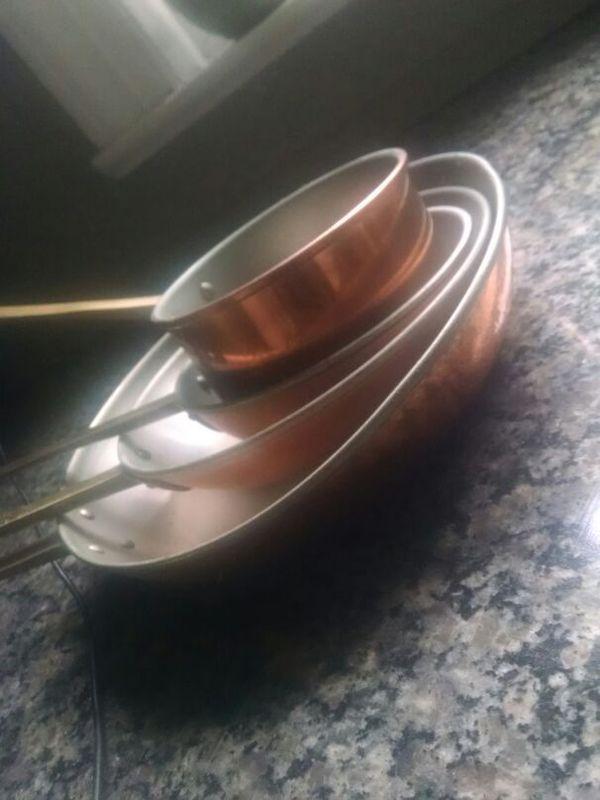 Set of 4 copper pots pans