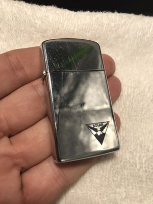 Vintage 1963 Zippo Slim Lighter w/ Solar Logo for Sale in La Mesa, CA