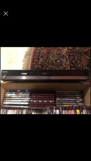 HD TOSHIBA DVD PLAYER WITH REMOTE AND BOX OF 79 DVD'S for Sale in Wichita, KS