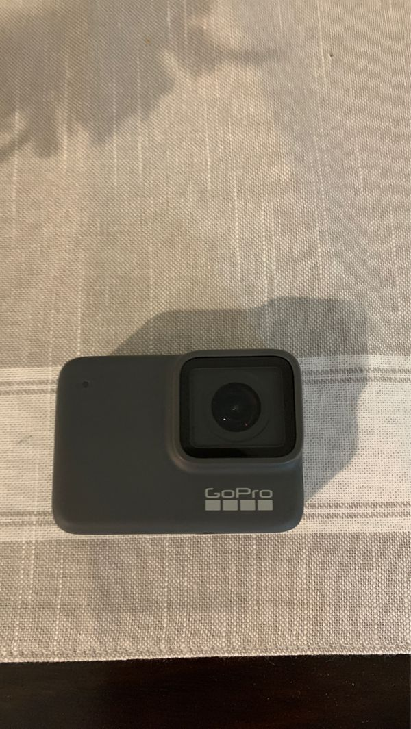 GoPro hero 7 silver with tripod and 256 GB micro SD card