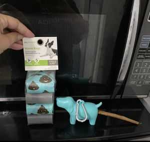 Doggie shaped holder with dog waste bags for Sale in Miami, FL